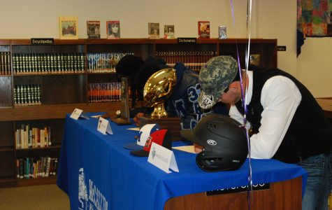 Three seniors sign the dotted line