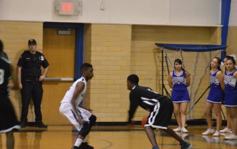 Basketball starts off district play with a win