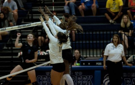 Varsity volleyball plays Cedar Creek in the first district game