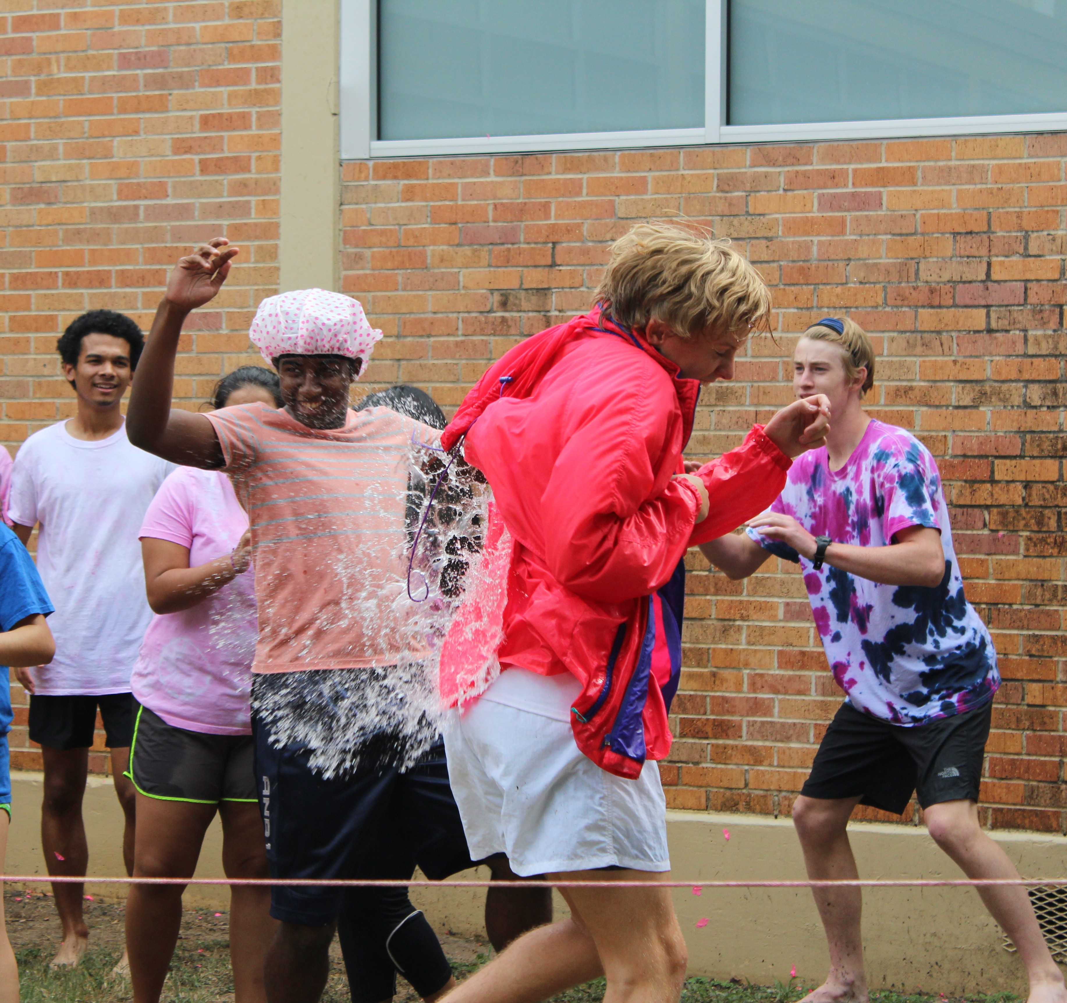 Senior David Ruwwe takes a water balloon to the back during the PALS annual Pink Week fundraiser