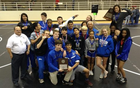Girls defend district title; boys finish 2nd
