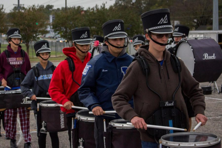 Follow Mac band through their day at a state competition