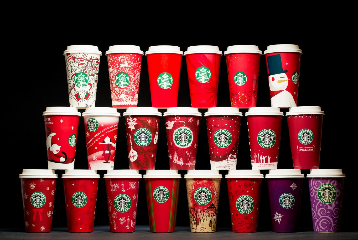 The cup designs starting from 1997 [bottom row right side] to 2017 [top row left side]. The different designs changes can be noticed as the designs decrease the amount of Christmas spirit included. Photo from Starbucks Newsroom. Reprinted with permission.