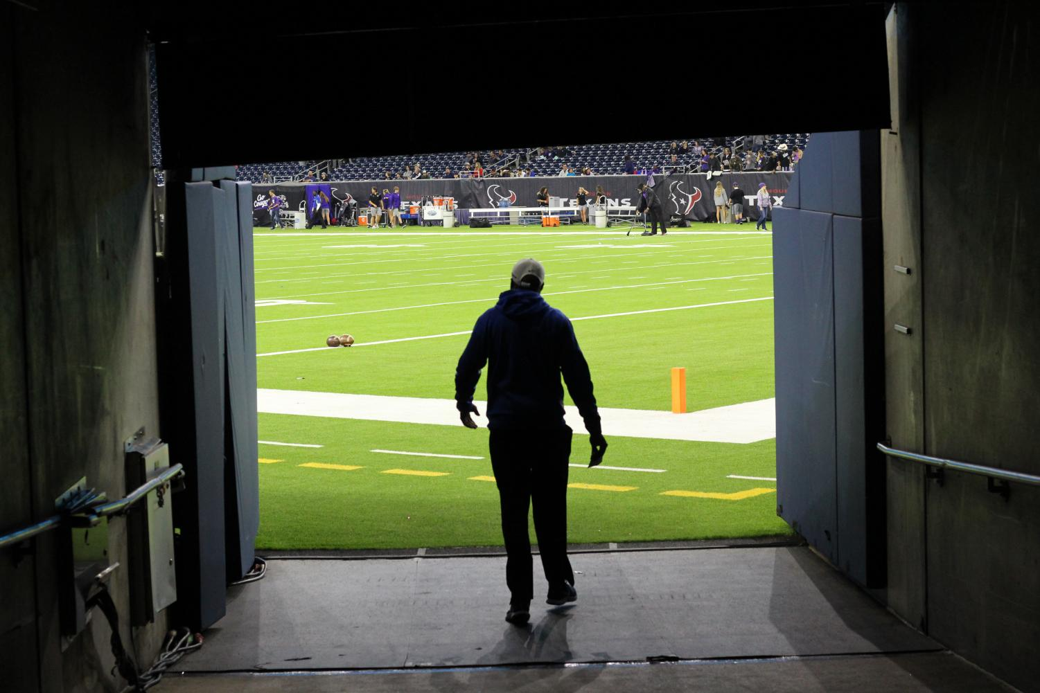 Taylor walks out on to the field at NRG Stadium where the Knights played in the 5A Divsion 2 semifinals. Photo by Madison Olsen.