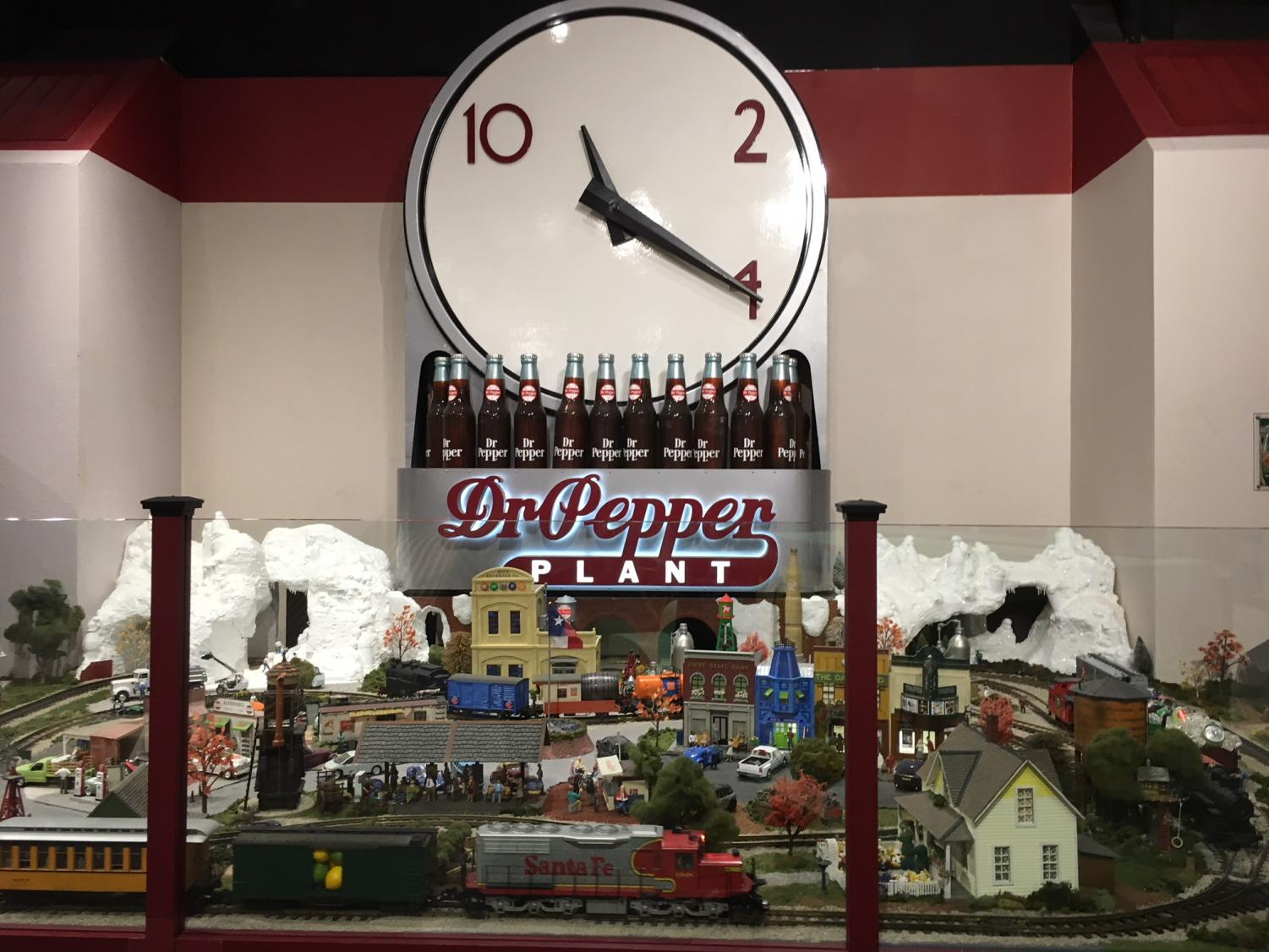 "One of the last attractions of the Dr. Pepper museum is the miniature town and Dr. Pepper conveyor belt, all under the classic clock logo. The logo was first used in the '20s and '30s with the slogan, ""Drink a bite to eat at 10, 2 and 4."