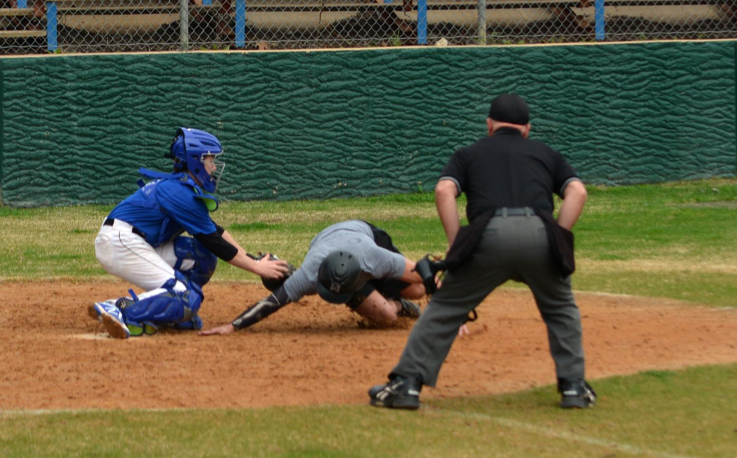 In his first MAC Alumni Game, freshman catcher made a big impact, applying this tag to thwart a double steal and then stroking a two-out RBI single to tie the score at 4. Photo by Dave Winter.