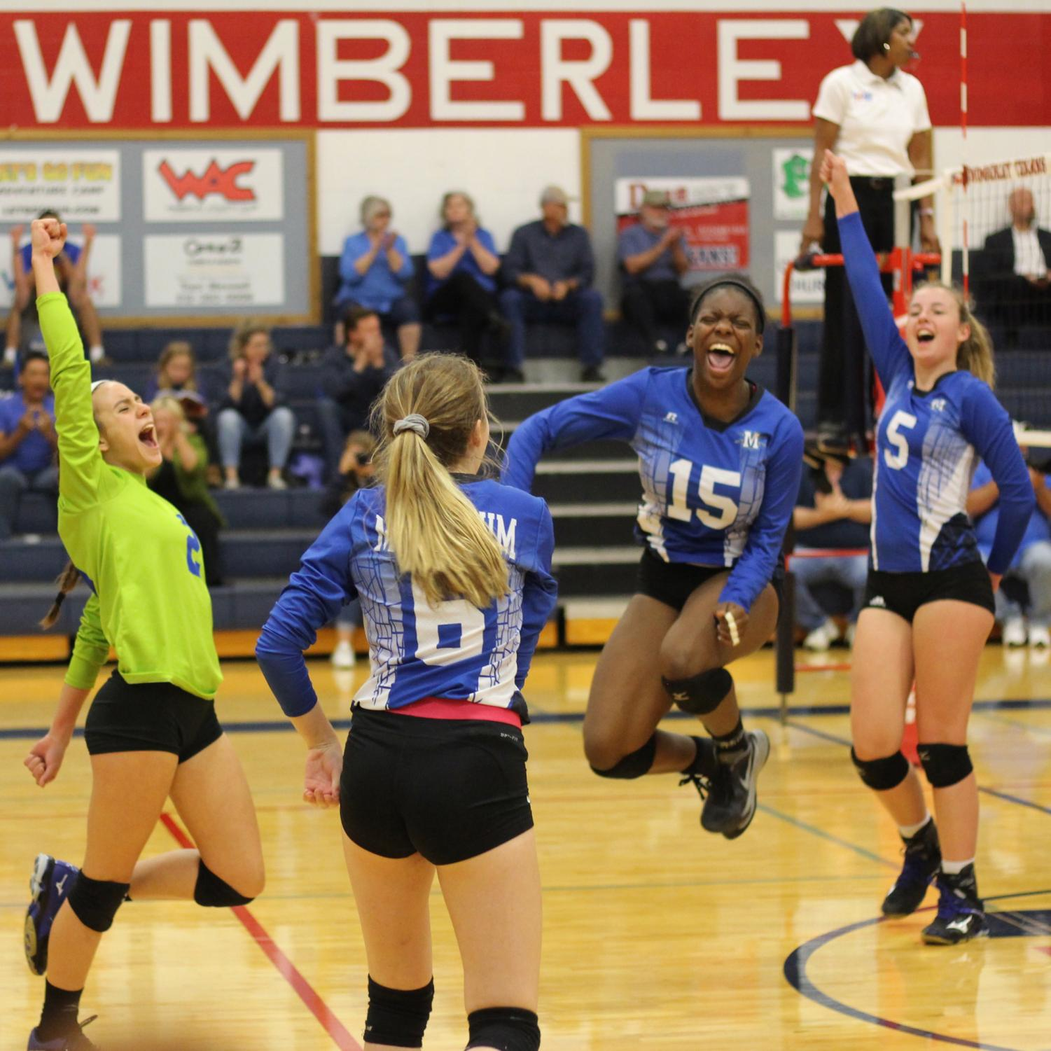 """Senior Madison Olsen won a Sweepstakes Award in sports photography for her Oct. 30 photo """"Point Taken,"""" which depicted 2017 volleyball players celebrating after scoring a point in their bi-district playoff match against Kerrville Tivy in Wimberley. """"This photo captures the moment perfectly,"""" the judges said. """"Volleyball players are so expressive after every point. That makes the sport so fun to photograph. This point seems even more consequential than normal ones because of the emotions on the players' faces. Congratulations to the photographer for not just sticking with the action of the individual plays, but watching what happens afterward."""""""