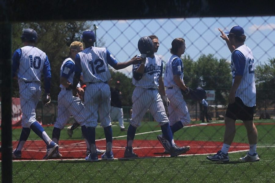 Shortstop+Eric+Worden+is+congratulated+after+his+three-run+homer+in+the+fifth+inning+brought+the+Knights+to+within+two+runs+at+5-3.+Photo+by+Joseph+Cardenas.