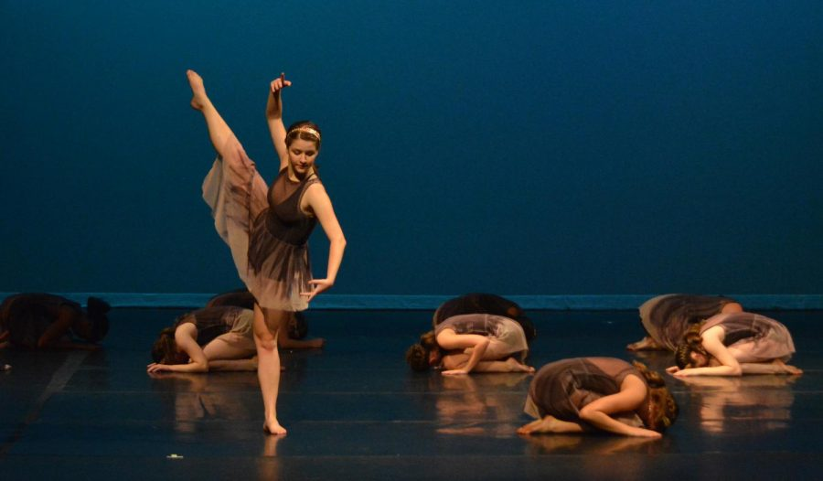 COMPANY%27S+COMING%3A+Members+of+the+McCallum+Youth+Dance+Company+perform+both+student+choreographed+and+faculty+choreographed+pieces+during+the+dress+rehearsal+for+their+show+%E2%80%9CTRADITIONS%2C+innovating.%E2%80%9D+Senior+Aubrey+Brown+rises+from+the+underworld+in+%E2%80%9CJus+de+Grenade%E2%80%9D+choreographed+by+Rachael+Murray.+%E2%80%9CGetting+to+play+Mother+Earth+coming+from+the+underground+is+unreal%2C+and+I+never+thought+I+would+get+to+play+a+graceful+yet+sinister+character%2C%E2%80%9D+fellow+senior+and+company+member+Keanna+Haynes+said.+%E2%80%9CThis+piece+is+very+beautiful%2C+and+it+has+different+stories+imbedded+into+one.%E2%80%9D+Photo+by+Annabel+Winter.+