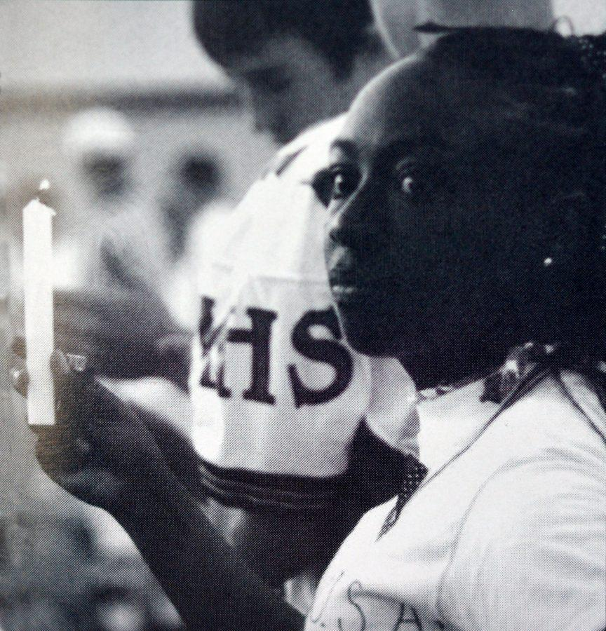 Senior Nicole Cummings hold her lighted candle in a show of support for the victims of the Sept. 11 attacks. Photo by Jessika Mann.