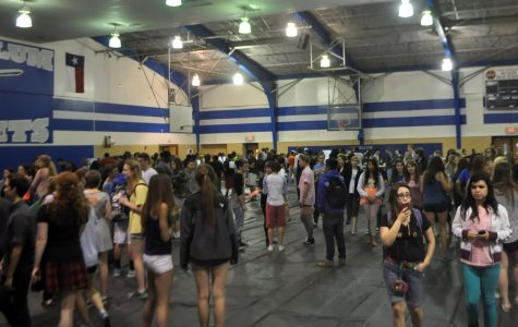 Students walked around the gym and looked at different booths during the fair as they considered which electives they want to join next school year.