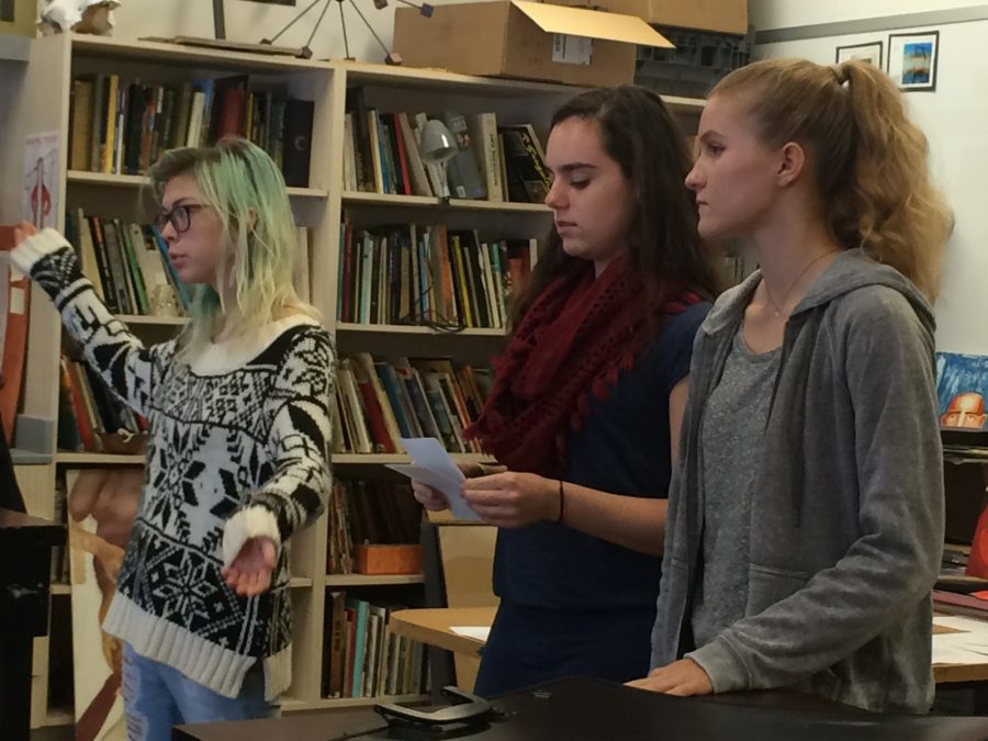"""Seniors Clarissa Thompson, Sarafina Fabris-Green and Mia Battle speak during a National Art Honor Society meeting. """"It's meant to promote service hours that are related to art activities,"""" Fabris-Green said. Photo by Ruby Dietz"""
