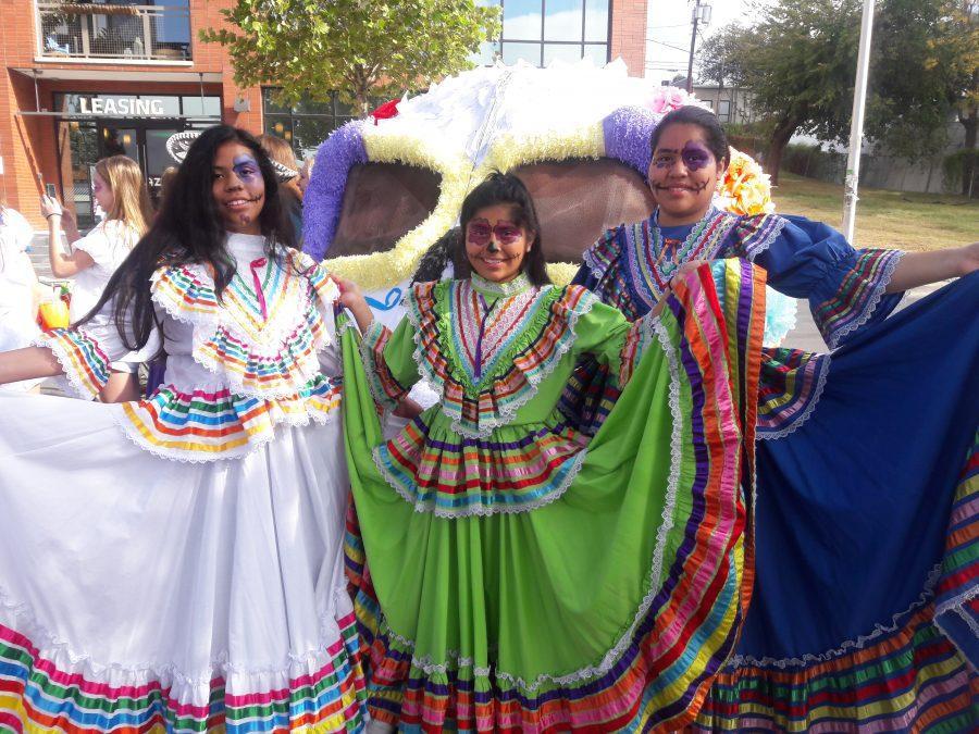 Sophomores Gissello Regino and Cecilia Castro (and Castro's sister) show off their festive Jalisco dresses at the parade.