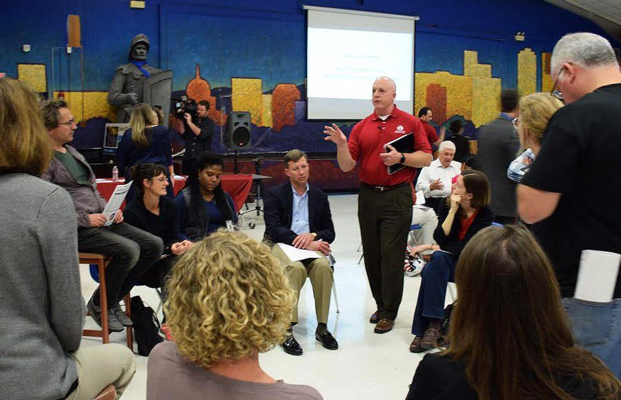 An AISD official moderates a Facilities Master Plan discussion between McCallum teachers and parents. Photo by Sophie Ryland.