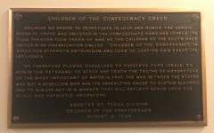 The Children of the Confederacy Creed plaque was erected in 1959 in the Texas Capitol. Today, many Texans see it as a false rendition of the history of the Confederacy. Texas House Speaker Joe Straus and other lawmakers have voiced their opinion that it be taken down because its message isn't historically accurate. Photo by Emma Baumgardner.