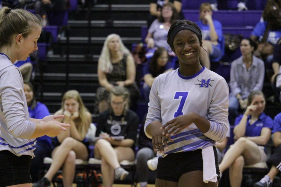Arnold is all smiles during the Knights' four-set road victory at LBJ on  Sept. 12. Photo by Lily McCormick.