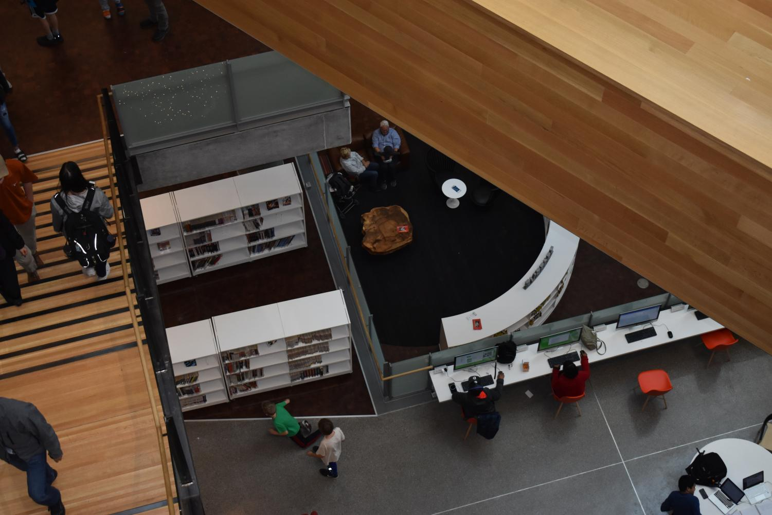 Thanks to the library's open concept, you can see the bottom floor from the seventh and top floor.  The open concept also makes the library environmentally friendly because with the natural light there is less need for artificial lights, which saves power. Photo by Olivia Watts.