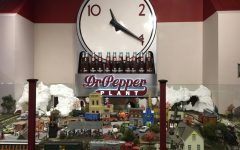 """One of the last attractions of the Dr. Pepper museum is the miniature town and Dr. Pepper conveyor belt, all under the classic clock logo. The logo was first used in the '20s and '30s with the slogan, """"Drink a bite to eat at 10, 2 and 4."""