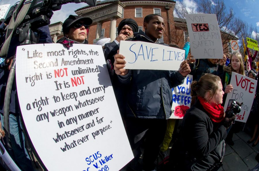 Gun+control+advocates+brandish+signs+lamenting+gun+violence+at+the+Prevent+Gun+Violence+Rally+on+Lawyer%27s+Mall+in+front+of+the+State+House+in+Annapolis%2C+Md.+on+March+1%2C+2013.+Almost+five+years+later%2C+the+fight+for+gun+control+is+no+less+urgent.+Photo+by+Jay+Baker.+Accessed+through+Flickr+Creative+Commons.+Reposted+with+permission+and+without+modification.