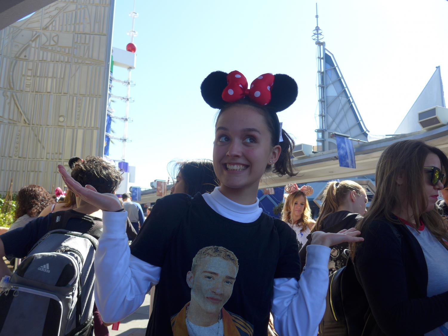 Sophomore Abby Green shows off her ears while waiting in line for rides at Disneyland. On Sunday, the final full day in California, students were given the choice to either go to the main Disneyland park or to California Adventure Park and enjoy food, music, and fun. Photo by Kristen Tibbetts