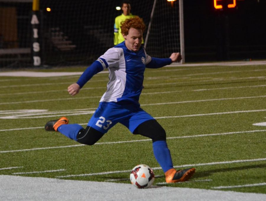 Jerry Howard sends the ball downfield during the Knights' 2-0 victory over Reagan on March 9 at Nelson Field. The win was the team's eighth victory during a nine-game unbeaten streak to end the regular season.  Photo by Isaias Cruz.
