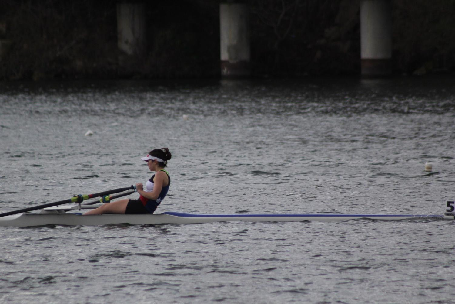 Dorothy Childs of the Texas Rowing Center rows on Lady Bird Lake on March 4. Rowing is one of several off-campus sports that is eligible for off-campus PE credit through AISD. Photo by Sarah Slaten.