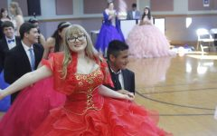 Sophomores Lucy Smith and Richard Hernandez dance at the McCallum High School Ballet Folklórico Quinceañera tonight. Of the 16 McCallum girls who participated in the event, some had never had a quinceañera, some were celebrating their quinceañera for a second time, and four were celebrating their real quinceañeras. The quinceañera started with a dance routine that the 16 girls and their partners practiced everyday at lunch for two weeks and was followed by lots of food, music and more dancing. McCallum Spanish teacher, Juana Gun, coordinated the event for the third straight year in order to give McCallum girls a chance to participate in the Latino cultural celebration.
