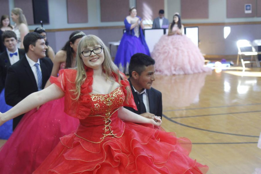 Sophomores Lucy Smith and Richard Hernandez dance at the McCallum High School Ballet Folklórico Quinceañera tonight. Of the 16 McCallum girls who participated in the event, some had never had a quinceañera, some were celebrating their quinceañera for a second time, and four were celebrating their real quinceañeras. The quinceañera started with a dance routine that the 16 girls and their partners practiced everyday at lunch for two weeks and was followed by lots of food, music and more dancing. McCallum Spanish teacher, Juana Gun, coordinated the event for the third straight year in order to give McCallum girls a chance to participate in the Latino cultural celebration. This started when one of my Ballet Folklorico girls said, Mrs. Gun, did you have a quinceañera? and I said, No, my family couldnt afford it, Gun said. So, we brainstormed how we could have a McCallum High School quinceañera for people that wanted to be in it. Photo and reporting by Steven Tibbetts.