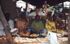 Richard Cowles poses with women selling garlic, dried ginger and tomato powder during his daily visit to the market in Chad in 1994, where he was stationed as a member of the Peace Corps from 1993-1996.