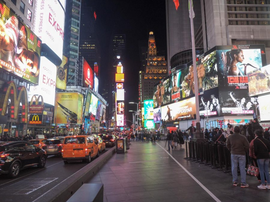 The major tourist destination Times Square sits at Broadway and 7th avenue. The area is brightly lit even at night with the large screens showing advertisements for movies and T. V shows. Times Square has been called The Center of the Universe and sees 50 million visitors each year