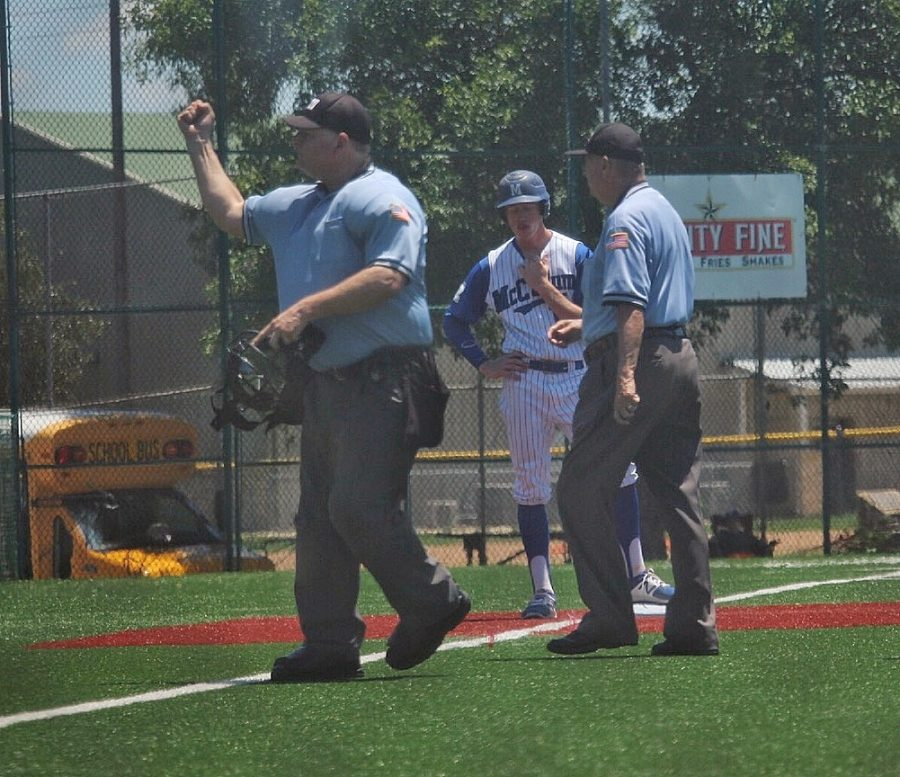 The umpire rules Mason Bryant out for offensive interference to end the bottom of the fifth inning. Photo by Joseph Cardenas.