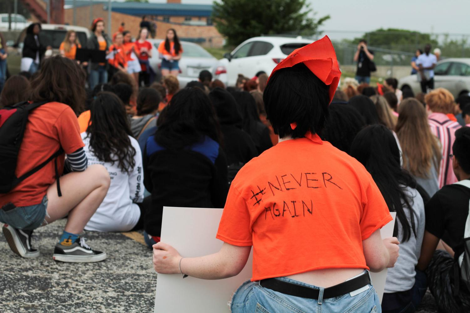 Students listen as senior Isabel Lerman reads a list of student demands to make schools safer. Between 300 and 400 students walked out of first period at 10 a.m. to participate in a McCallum walkout, part of National Student Walkout to advocate for tighter gun control laws. Photo by Ian Clennan.
