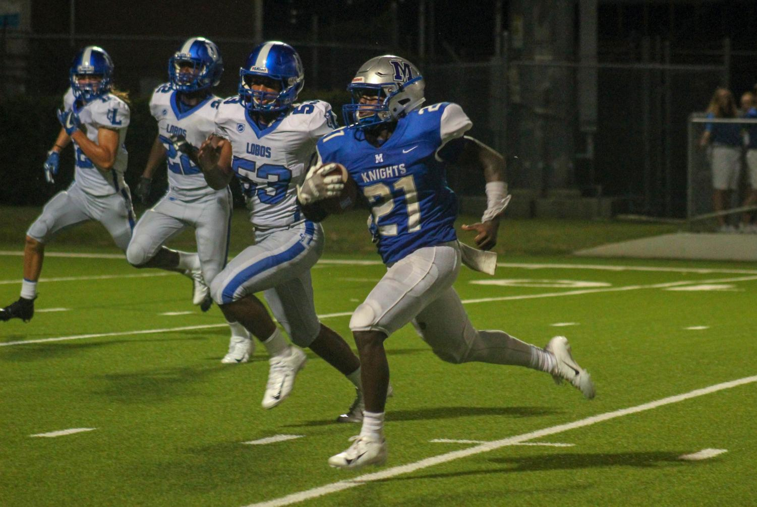 Jalen Sutton ran for 252 yards and three touchdowns from scrimmage and ran back a kickoff 88 yards for another touchdown on the games opening play. Photo by Annabel Winter.