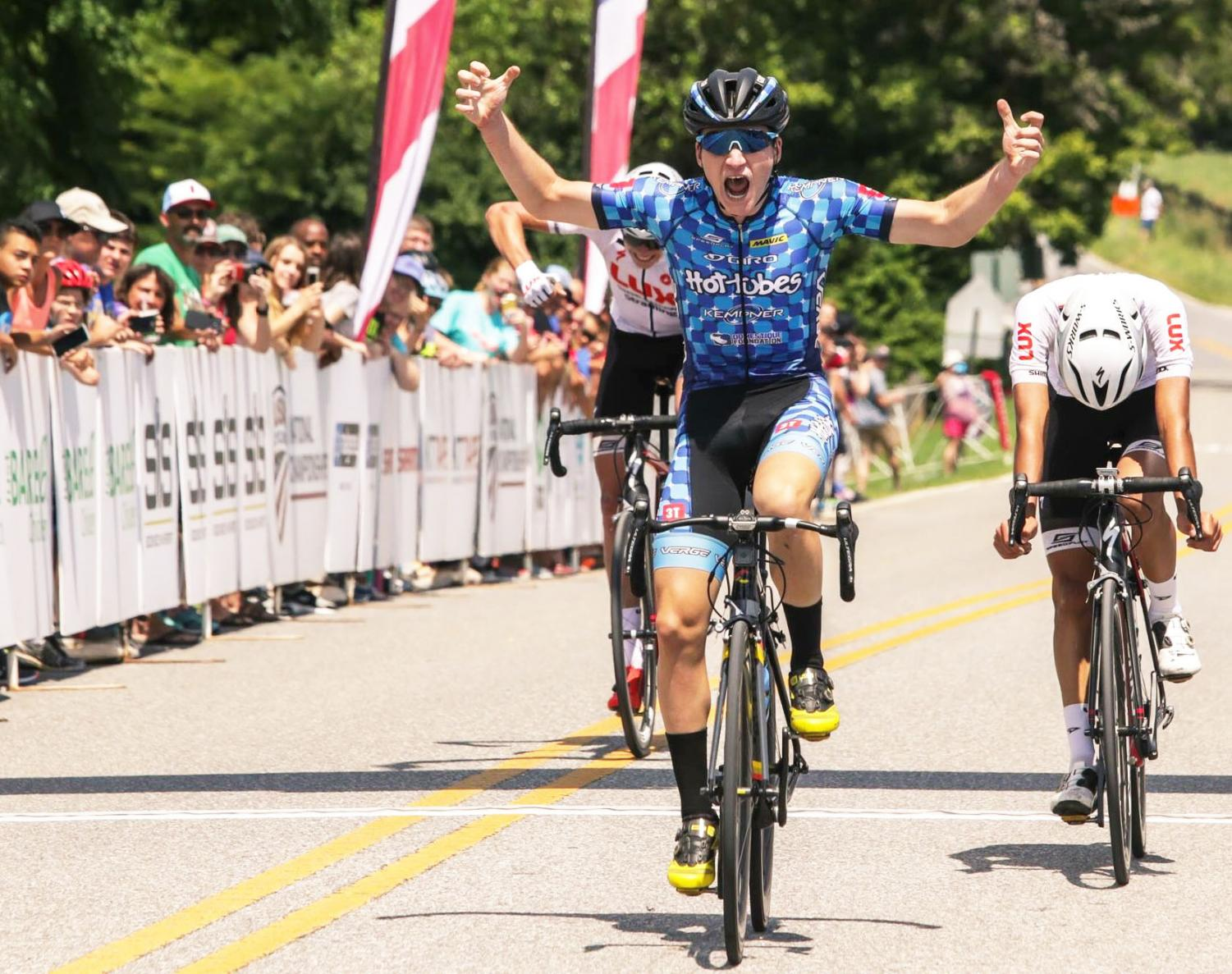 "Eli Husted crosses the finish line at the Amateur Road National Championship in first place. The race came down to the end before Husted pushed ahead in the final meters. ""I proved that I'd worked harder than they had, and they were more tired,"" Husted said. ""I knew I could get them at the line, so I just brought them there."""