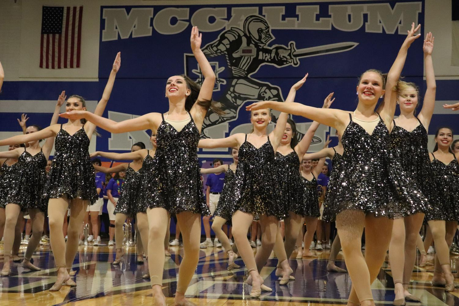 The Blue Brigade performs during the Taco Shack pep rally on Aug. 30 in the large gym. Photo by Gabby Sherwood.