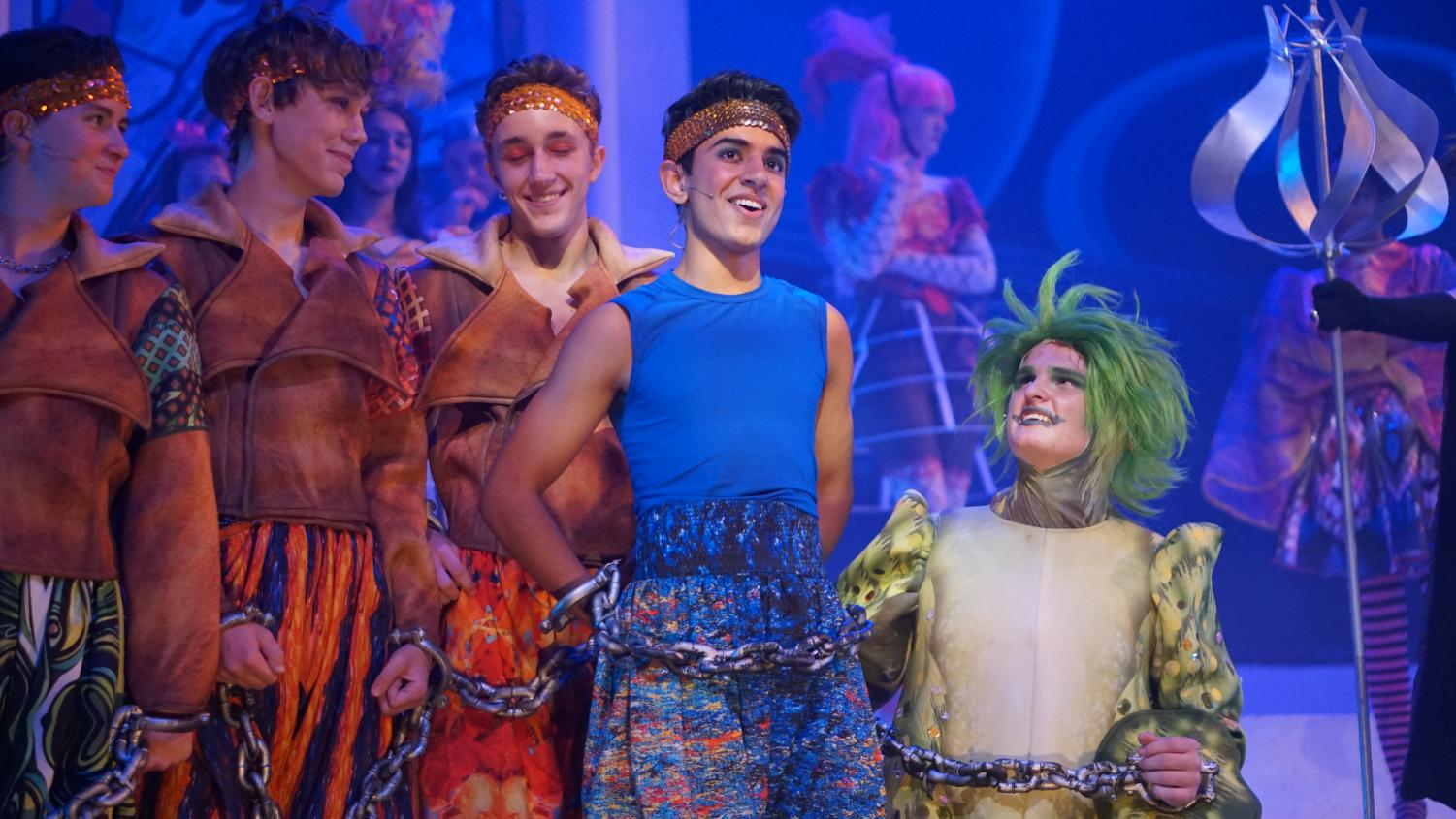 MITE TIME: The Starmites, played by juniors Javier Garcia, Sam Richter, Duval Bingham look at their leader Spacepunk, played by junior Tosh Arora as he sings M'lady. Photo by Jazzabelle Davishines