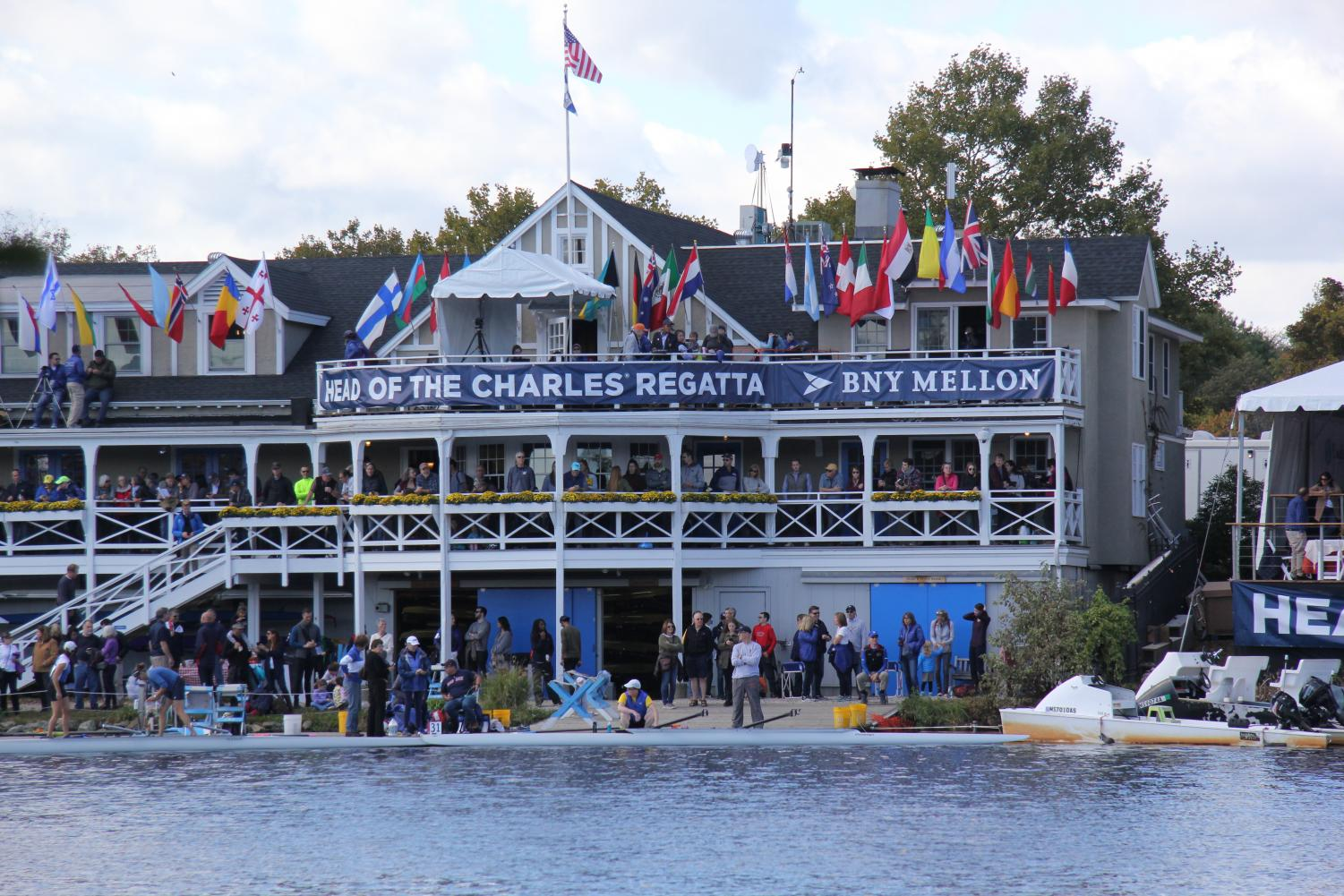 The BNY Mellon Boathouse was crowded with rowers, coaches and fans during the Head of the Charles Regatta on the Charles River in Boston on Oct. 20. For two days, thousands of elite rowers sprinted by the boathouse with the finish line in sight. Photo by Sarah Slaten.