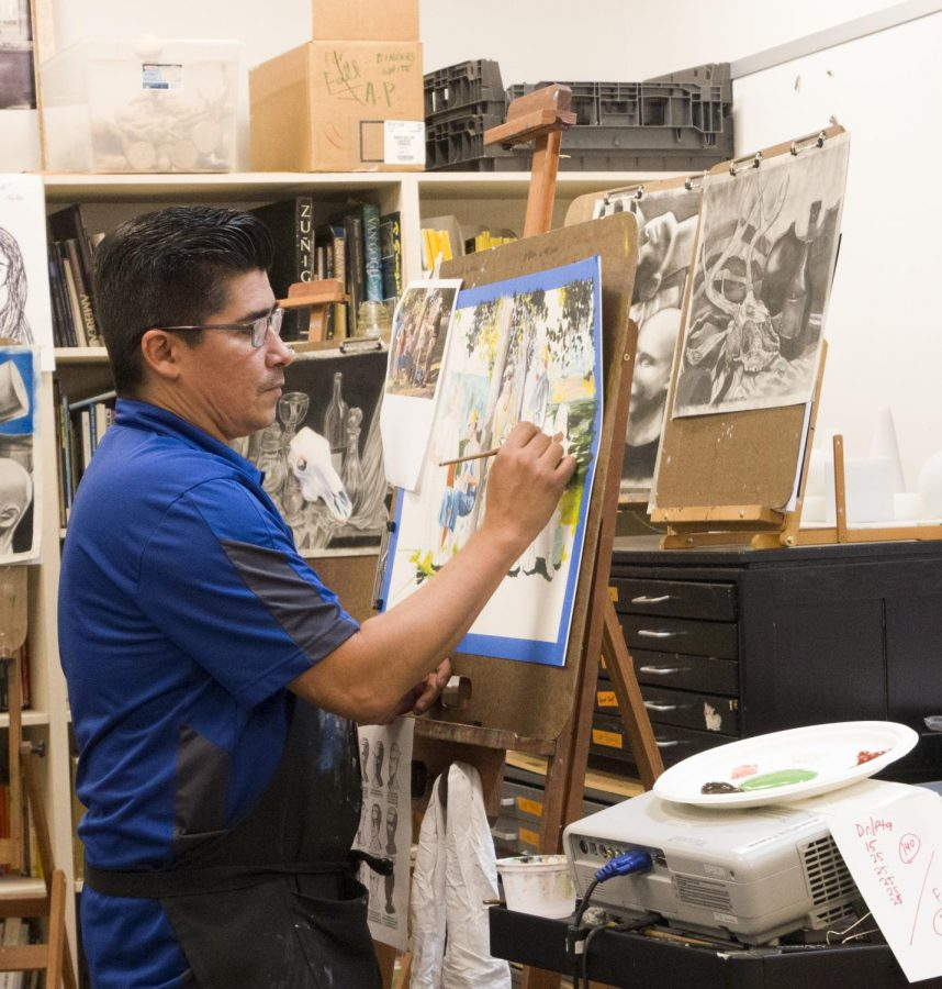 Mr.+Martinez+paints+for+the+painting+students+in+his+first+period+classes.+The+class+contains+students+from+drawing+II%2C+drawing+III+and+painting+III+spread+throughout+the+room+and+hallway.+%E2%80%9C%5BThis+is%5D+why+we+do+stacked+classes%2C%E2%80%9D+Martinez+said.+%E2%80%9CSo+that+students+have+choices+about+where+they+can+go+at+different+periods+during+the+day.%E2%80%9D+Photo+by+Kristen+Tibbetts.