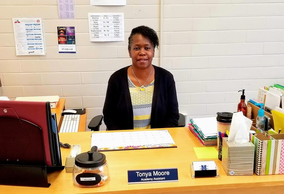 New Fine Arts Academy assistant Tonya Moore sits at her desk in the Fine Arts Office in the 600 hall. Moore has spent the last decade helping students stay on track academically and socially.
