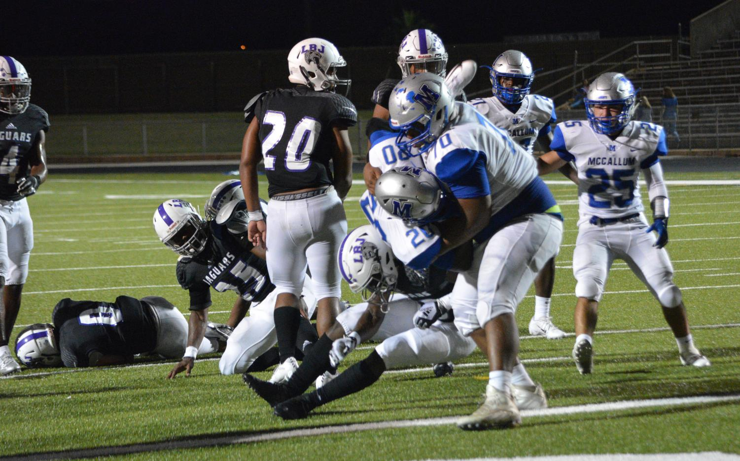 Alvino Carbajal has carried a huge load all season as he did in the LBJ game when he literally helped Deron Gage into the end zone for a touchdown. Both Carbajal and Gage have helped the team on offense and on defense this year. Photo by Dave Winter.