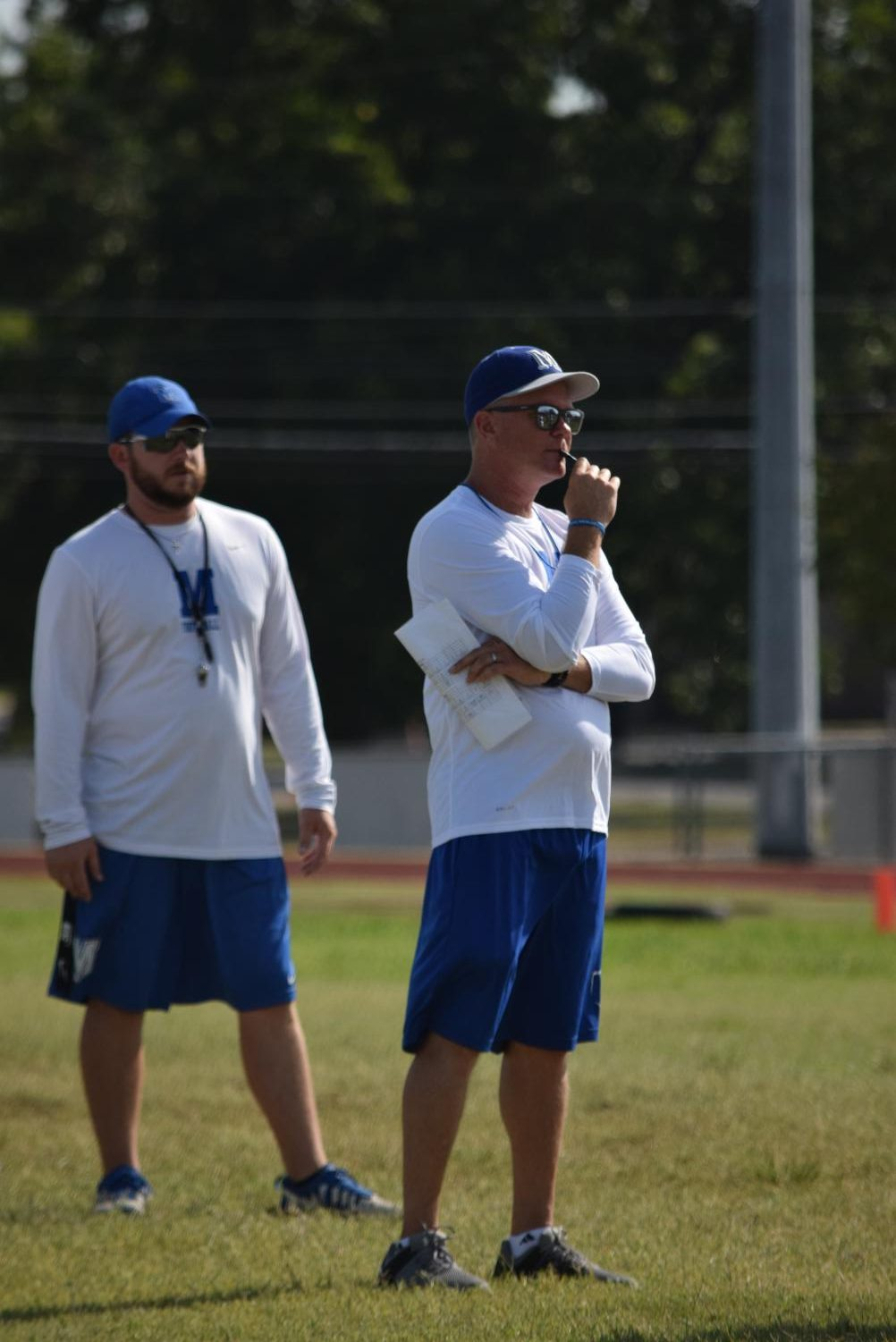 Searle, right, coached baseball last season at Lago Vista with new varsity baseball coach Brandon Grant, left. Both also coached football as shown here at the Blue-Gray Scrimmage to kick off the football season.