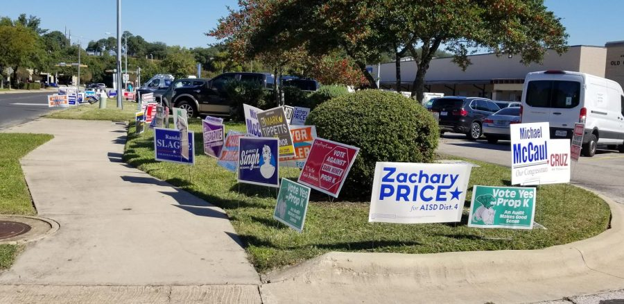 During+early+voting%2C+a+motley+mosaic+of+political+signs+borders+the+sidewalk+leading+to+the+Old+Quarry+Library+at+7051+Village+Center+Drive.