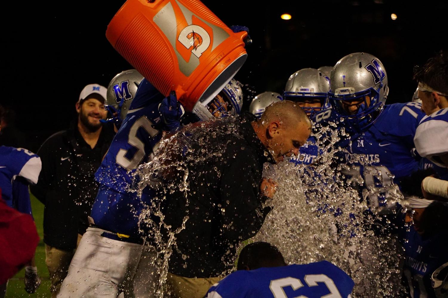 Coach G got a Gatorade shower following the Knights decisive win over Crockett in a game that all but punched the Knights' ticket to the playoffs.