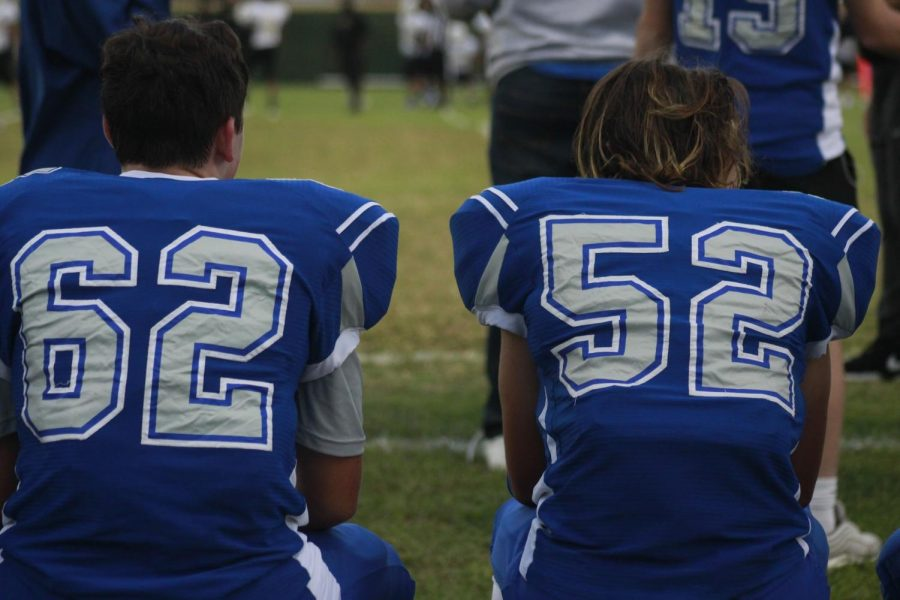 Gavin Freedman and Johan Holmes take a rare sideline break on the bench during the freshmen teams 60-6 win over Lanier on Oct. 11 at Nelson Field. About the only way to get the duo off the field is for there to be a blowout. The two were standout freshman players on both the offensive line and on defense, and they were key components of an award-winning drum line in marching band. Photo by Grace Nugent.