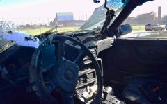 FROM BACKFIRE TO CAR FIRE: The inside of Rice's car was seriously burned. Along with a broken windshield and severely damaged dashboard, the seat coverings burned off.  Photo by Evelyn Griffin.
