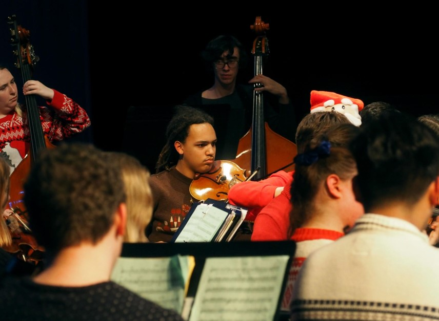 "VICIOUS VIOLAS: The viola section picks up the melody during the McCallum Orchestra's winter performance, with Danali Jah, very concentrated on his part. The concert featured classical pieces as well as holiday favorites arranged by McCallum's own Mr. Pringle and Mrs. Shockley. ""Being in orchestra is stressful and a lot of work;"" says Danali ""but fun and worth it for the final product."""