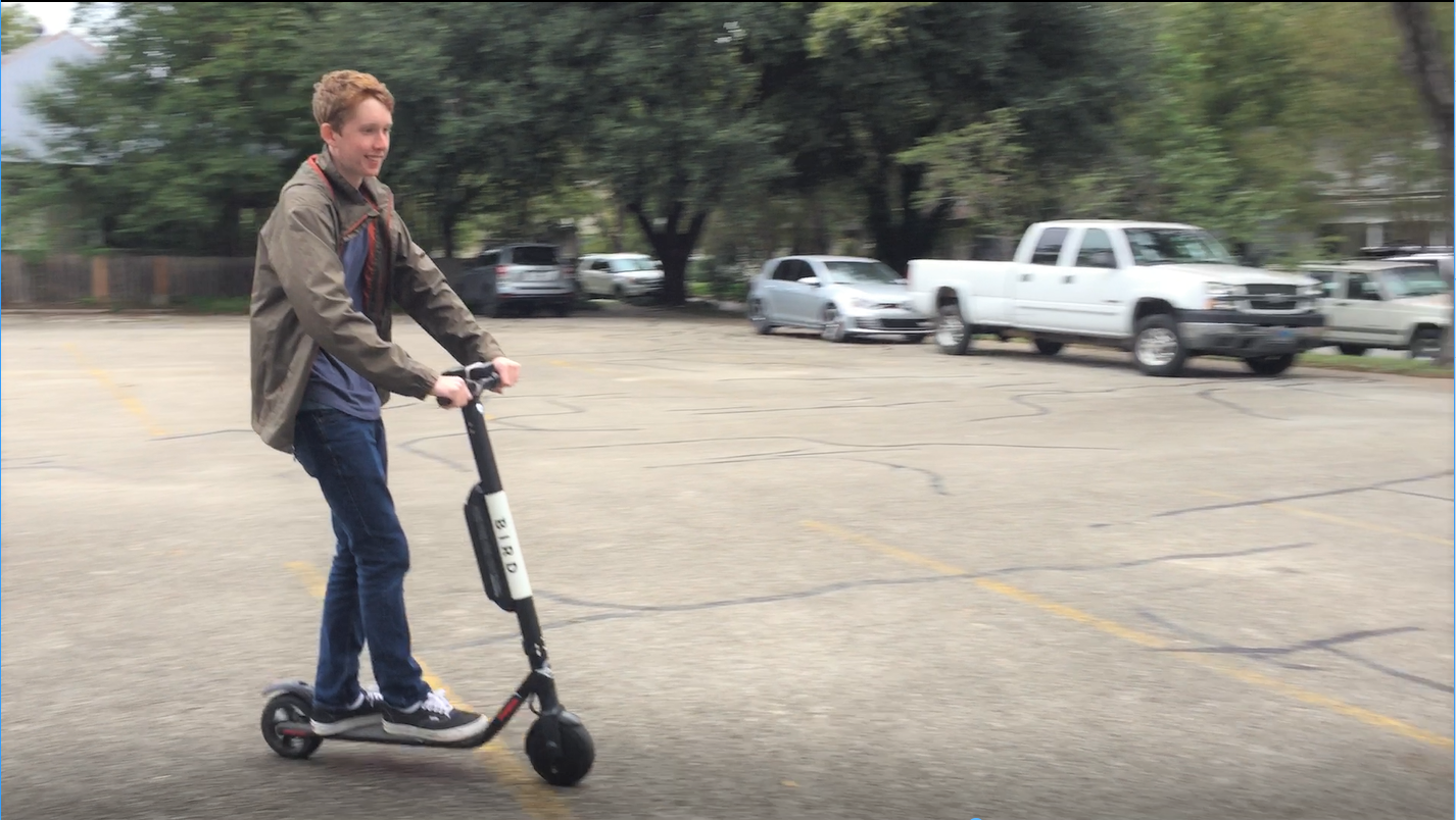 Rhodes takes a joy ride on a Bird scooter within the safety of a parking lot in the presence of a responsible adult (or at least so he claims).