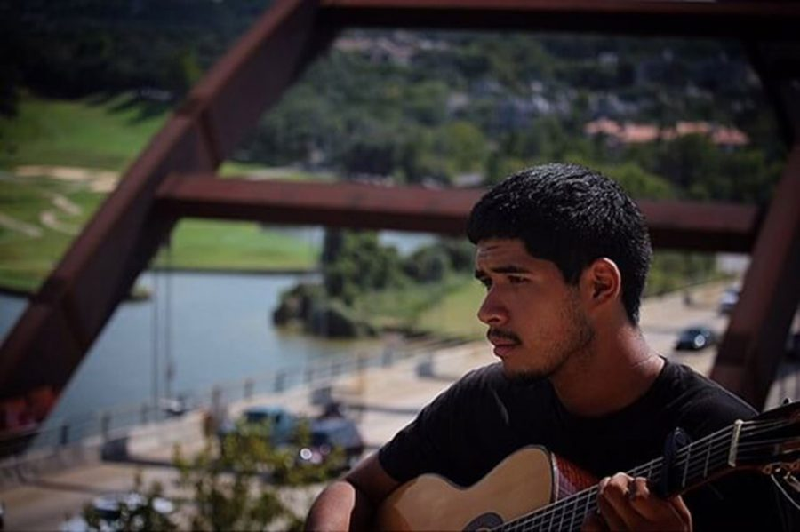 """Joseph Cardenas, Excellent, Portrait. STRUM AT 360: Senior Brandon Valdez goes to 360 Bridge to take in Austins sights while playing his guitar. """"Music is like a highway. You never know where it's going to take you."""" Photo by Joseph Cardenas."""
