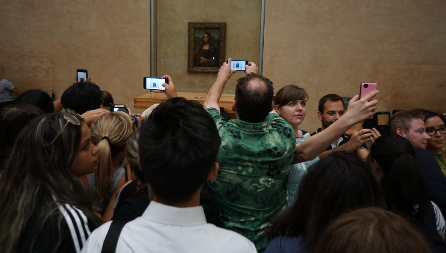 Perhaps when at the Louvre you should look at the Mona Lisa with your own eyes instead of through the lens of your SmartPhone. Just a thought.