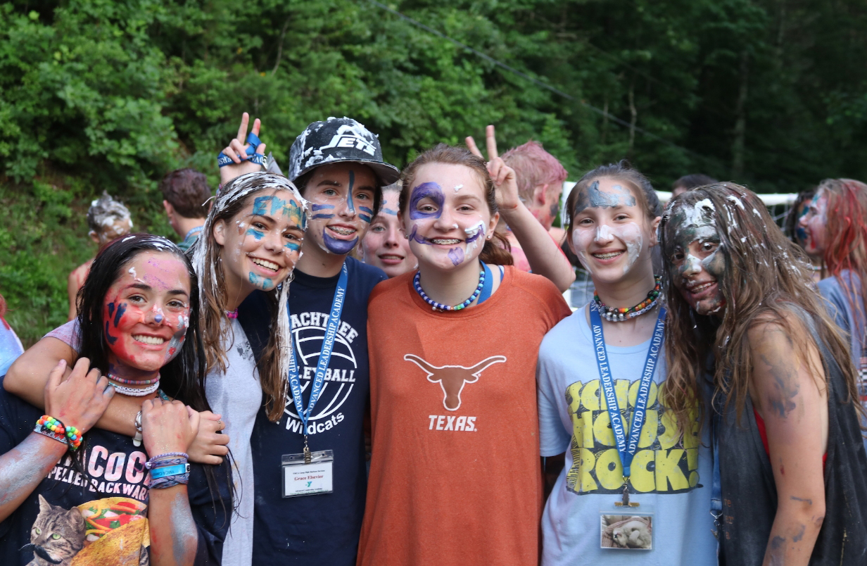 Freshman Annabel Winter and her friends from YMCA High Harbour, a camp in Georgia, pose for a picture during a de-stressing Friday at camp; the day's activities included painting each others' faces and throwing flour and shaving cream at each other.  Winter is a CIT this year.